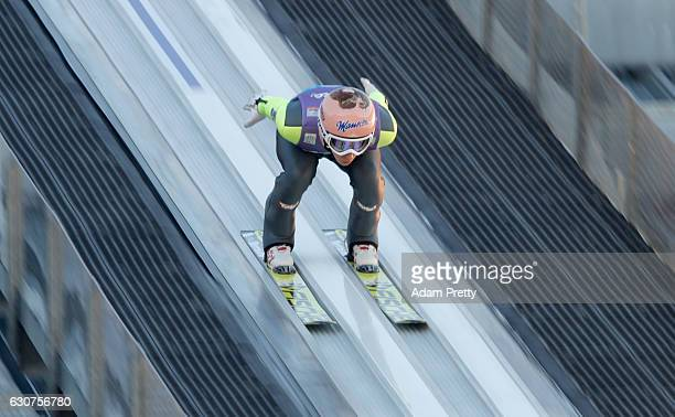 Stefan Kraft of Austria accelerates down the inrun during his practice jump on Day 2 of the 65th Four Hills Tournament ski jumping event on January 1...