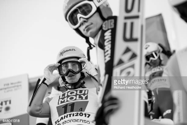 Stefan Kraft of Austria and Andreas Wellinger of German prepare to jump during the Men's Team Ski Jumping HS130 at the FIS Nordic World Ski...