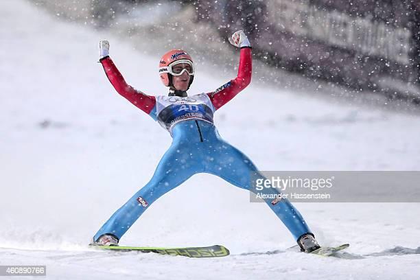 Stefan Kraft of Austria celebrates after his final jump on day 2 of the Four Hills Tournament Ski Jumping event at SchattenbergSchanze Erdinger Arena...
