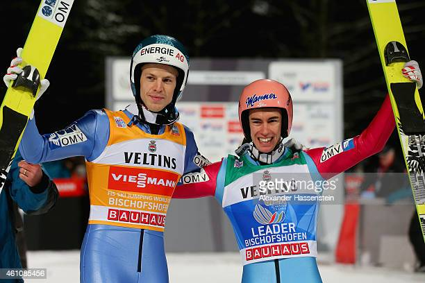 Stefan Kraft of Austria celebrates winning the Four Hills Tournament Ski Jumping event with his team mate Michael Hayboeck on day 8 of the Four Hills...