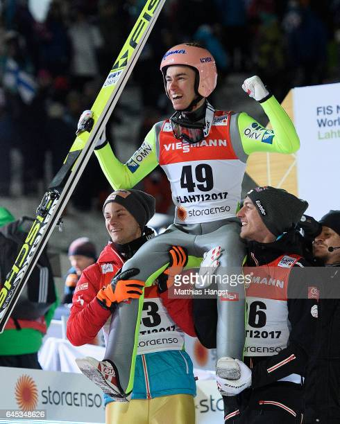 Stefan Kraft of Austria celebrates with his teammates Manuel Fettner of Austria and Gregor Schlierenzauer of Austria after his final jump in the...