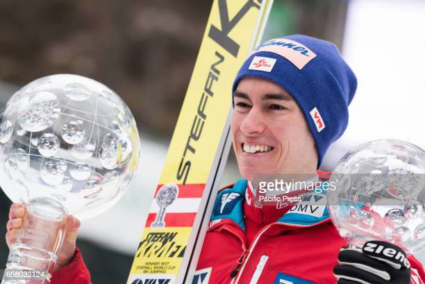 PLANICA SLOVENIA PLANICA SLOVENIA Stefan Kraft of Austria celebrating with both Crystal Globes for his first place in overall World Cup and Sky...
