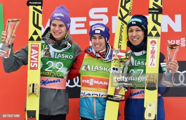 Stefan Kraft of Austria poses on the podium after winning the seasonending World Cup event in Planica Slovenia on March 26 alongside secondplace...