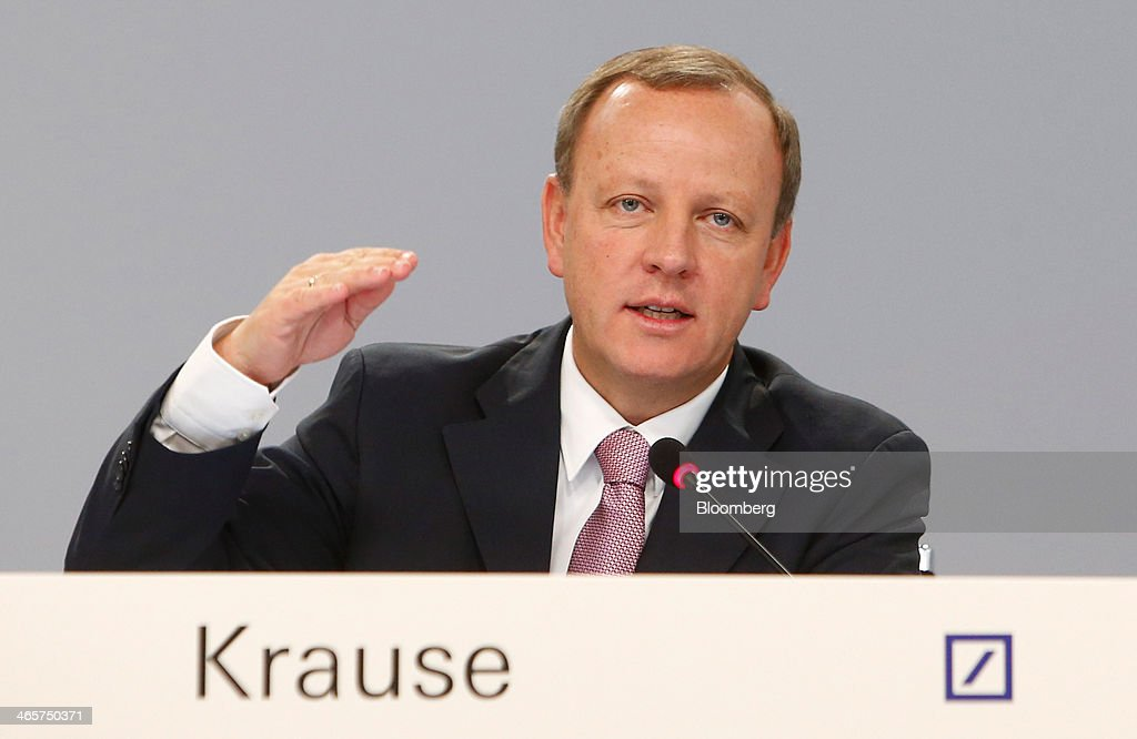 Stefan Krause, chief financial officer of Deutsche Bank AG, gestures as he speaks during a news conference to announce the bank's results at their headquarters in Frankfurt, Germany, on Wednesday, Jan. 29, 2014. Deutsche Bank AG, Germany's biggest bank, cut total compensation for employees at its investment bank 23 percent in the fourth quarter as a slide in revenue contributed to a loss for the period. Photographer: Ralph Orlowski/Bloomberg via Getty Images