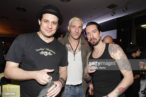 Stefan Kretzschmar and German country singers Sascha 'Hoss Power' Vollmer and Alec 'Boss Burns' Voelkel of the band The BossHoss attend the aftershow...