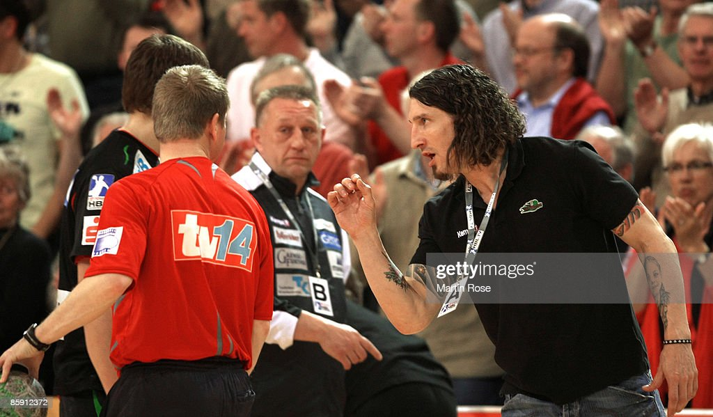 Stefan Kretzschmar (R), head coach of Magdeburg argues with referee Bernd Methe (L) during the Bundesliga game between SG Flensburg-Handewitt and SG Magdeburg at the Campus Hall on April 11, 2009 in Flensburg, Germany.