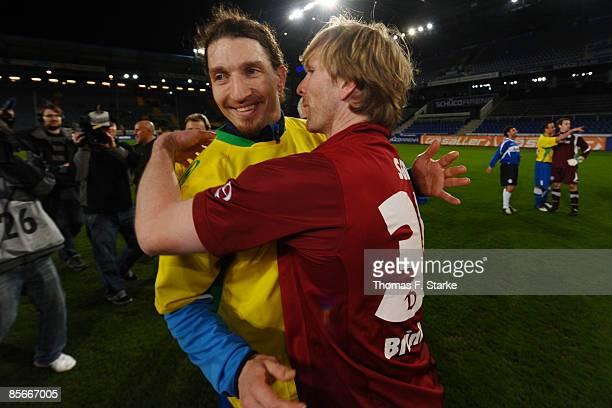 Stefan Kretzschmar hugs Ansgar Brinkmann after the Ansgar Brinkmann Farewell Match at the Schueco Arena on March 27 2009 in Bielefeld Germany