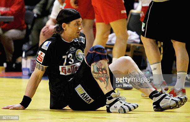 Stefan Kretzschmar of Magdeburg sits dejected on the ground during the EHF Cup Final between Tusem Essen and SC Magdeburg on May 7 2005 in Essen...