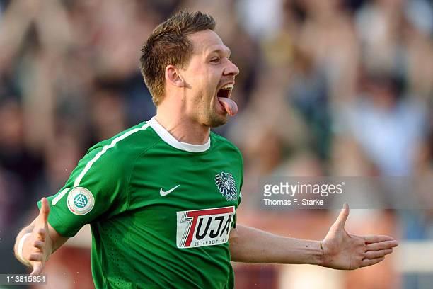 Stefan Kuehne of Muenster celebrates after scoring his team's second goal during the Regionalliga West match between Preussen Muenster and Borussia...
