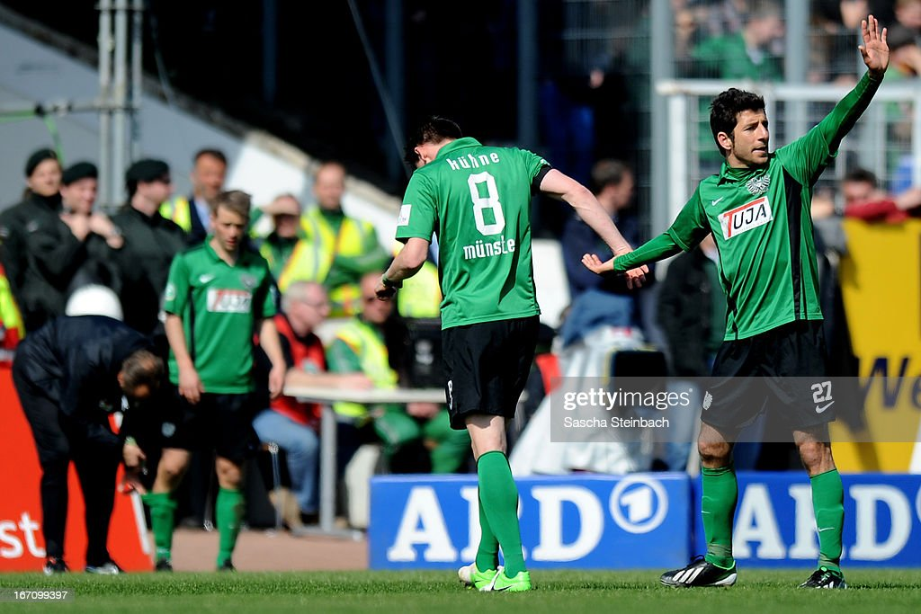 Stefan Kuehne (C) of Muenster leaves the pitch after picking up an injury during the 3. Liga match between Preussen Muenster and Karlsruher SC at Preussenstadion on April 20, 2013 in Muenster, Germany.