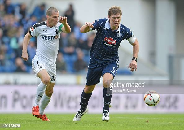 Stefan Kulovits of Sandhausen and Fabian Klos of Bielefeld fight for the ball during the Second Bundesliga match between Arminia Bielefeld and SV...