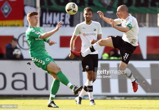 Stefan Kulovits of Sandhausen is challenged by Daniel Steininger of Greuther Fuerth during the Second Bundesliga match between SV Sandhausen and...