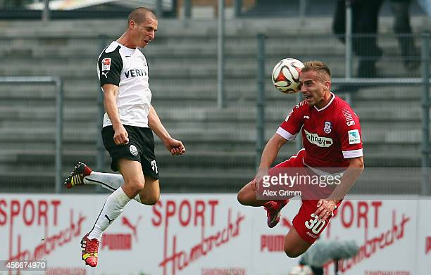 Stefan Kulovits of Sandhausen jumps for a header with Faton Toski of Frankfurt during the Second Bundesliga match between SV Sandhausen and FSV...