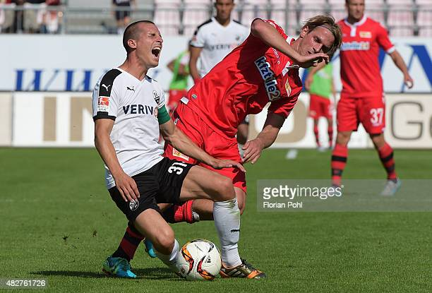Stefan Kulovits of SV Sandhausen and Soeren Brandy of 1FC Union Berlin during the game between SV Sandhausen and Union Berlin on August 2 2015 in...