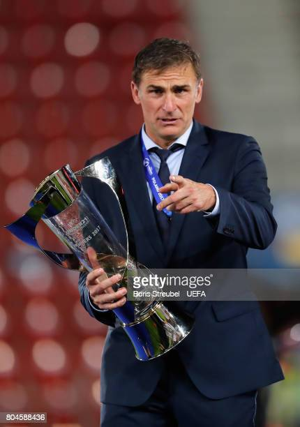 Stefan Kuntz coach of Germany celebrates with the trophy aftere the UEFA European Under21 Championship Final between Germany and Spain at Krakow...