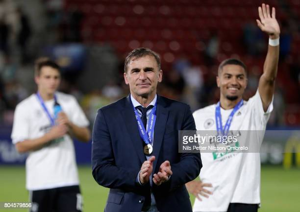 Stefan Kuntz coach of Germany shows appreciation to the fans after the UEFA European Under21 Championship Final between Germany and Spain at Krakow...