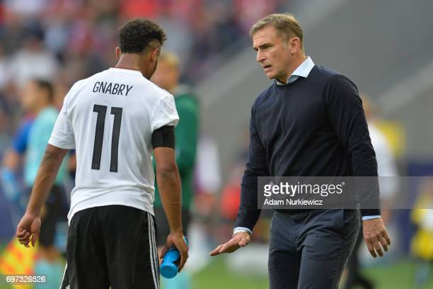 Stefan Kuntz coach of Germany tallks to Serge Gnabry during the UEFA European Under21 Championship Group C match between Germany and Czech Republic...