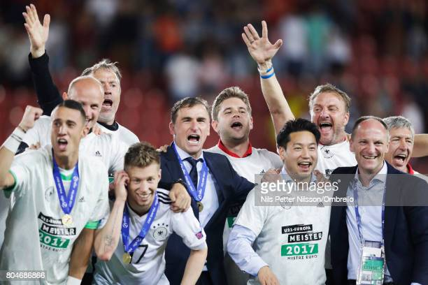 Stefan Kuntz head coach of Germany and players celebrates after the victory during the UEFA U21 Final match between Germany and Spain at Krakow...