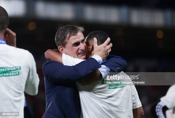 Stefan Kuntz head coach of Germany hugs Serge Gnabry of Germany during the UEFA U21 Final match between Germany and Spain at Krakow Stadium on June...