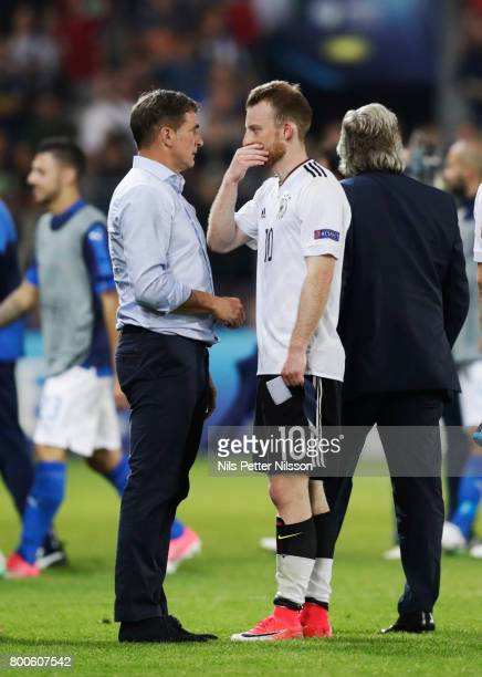 Stefan Kuntz head coach of Germany in discussion with Maximilian Arnold of Germany after the UEFA U21 championship match between Italy and Germany at...