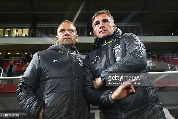 Stefan Kuntz head coach of Germany talks to Hansi Flick Sporting director of DFB prior to the 2017 UEFA European U21 Championships Qualifier between...