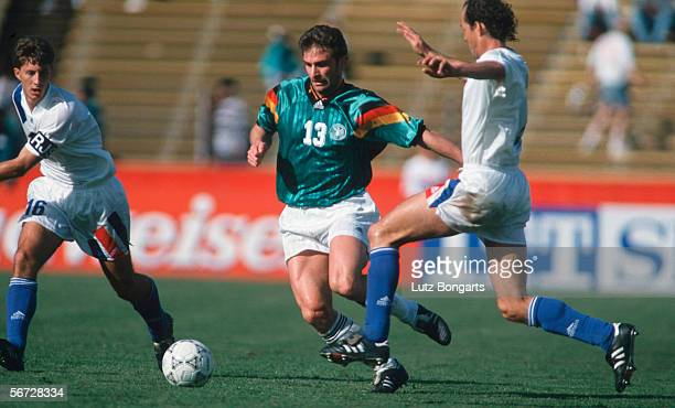 Stefan Kuntz of Germany and Tom Dooley of USA in action during the International Friendly match between USA and Germany on Dezember 18 1993 in San...