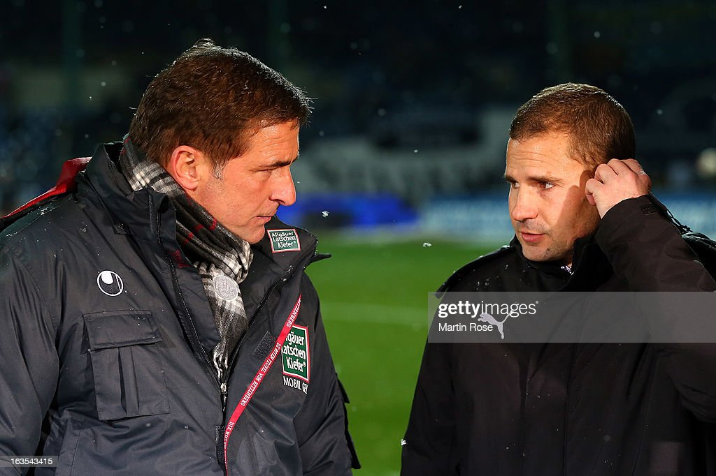 Stefan Kunz (L), sport director of Kaiserslautern talks to Marc Arnold, sport director of Braunschweig before the second Bundesliga match between Eintracht Braunschweig and 1. FC Kaiserslautern at Eintracht Stadium on March 11, 2013 in Braunschweig, Germany.
