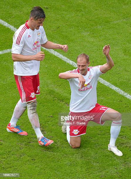 Stefan Kutschke and Matthias Morys of Leipzig celebrate their teams second goal during the Regionalliga Playoff First Leg match between between...