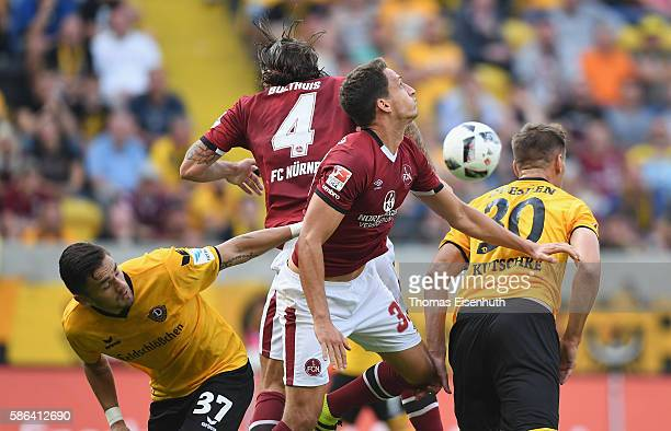 Stefan Kutschke and Pascal Testroet of Dresden are challenged by Georg Margreitter and Davy Bulthuis of Nuernberg during the Second Bundesliga match...