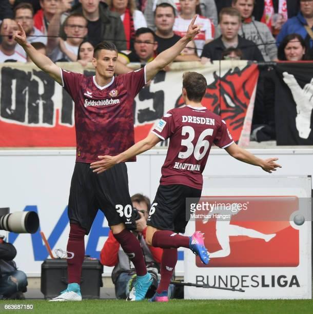 Stefan Kutschke of Dresden celebrates scoring the first goal with Niklas Hauptmann during the Second Bundesliga match between VfB Stuttgart v Dynamo...