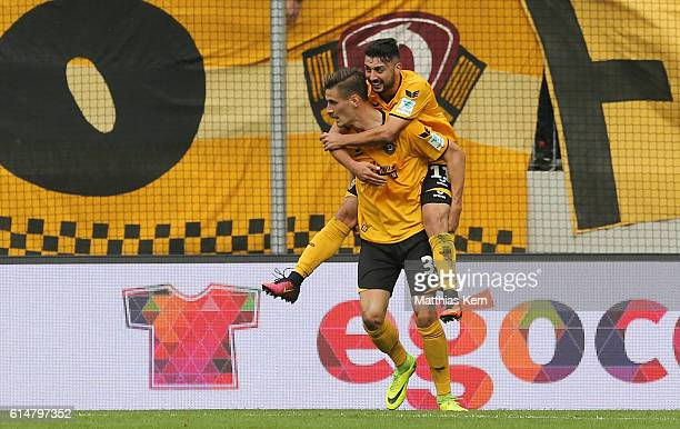 Stefan Kutschke of Dresden jubilates with team mate Aias Aosman after scoring the first goal during the Second Bundesliga match between SG Dynamo...