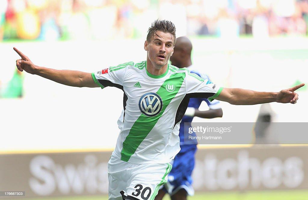 Stefan Kutschke of Wolfsburg celebrates after scoring their fourth goal during the Bundesliga match between VfL Wolfsburg and FC Schalke 04 at Volkswagen Arena on August 17, 2013 in Wolfsburg, Germany.