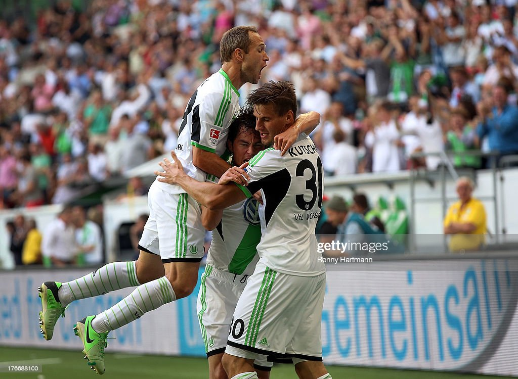 Stefan Kutschke (R) of Wolfsburg celebrates with team-mates <a gi-track='captionPersonalityLinkClicked' href=/galleries/search?phrase=Jan+Polak&family=editorial&specificpeople=547877 ng-click='$event.stopPropagation()'>Jan Polak</a> (L) and <a gi-track='captionPersonalityLinkClicked' href=/galleries/search?phrase=Marcel+Schaefer&family=editorial&specificpeople=656515 ng-click='$event.stopPropagation()'>Marcel Schaefer</a> after scoring their fourth goal during the Bundesliga match between VfL Wolfsburg and FC Schalke 04 at Volkswagen Arena on August 17, 2013 in Wolfsburg, Germany.