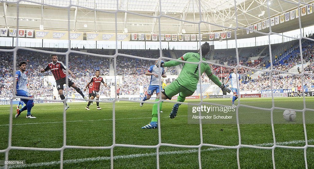 Stefan Lex of FC Ingolstadt scores the first goal for his team against OIiver Baumann of Hoffenheim during the first bundesliga match between 1899 Hoffenheim and FC Ingolstadt at Wirsol Rhein-Neckar-Arena on April 30, 2016 in Sinsheim, Germany.