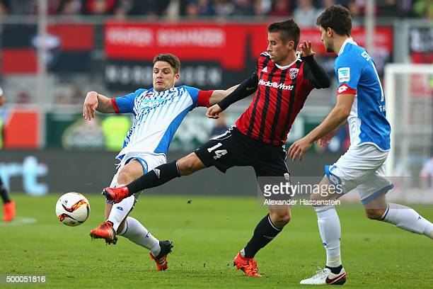 Stefan Lex of Ingolstadt battles for the ball with Pirmin Schwegler of Hoffenheim and his team mate Tobias Strobl during the Bundesliga match between...