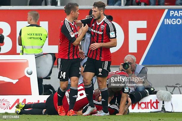 Stefan Lex of Ingolstadt celebrate with his team mate Mathew Leckie the first team goal during the Bundesliga match between FC Ingolstadt and...