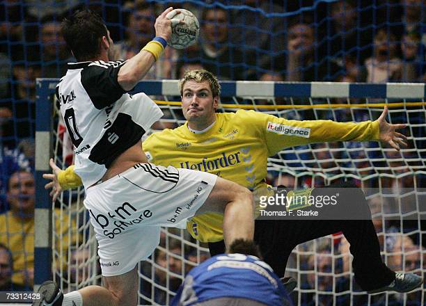Stefan Loevgren of Kiel jumps to shoot against Carsten Lichtlein of Lemgo during the Handball DHB Cup game between TBV Lemgo and THW Kiel at the...