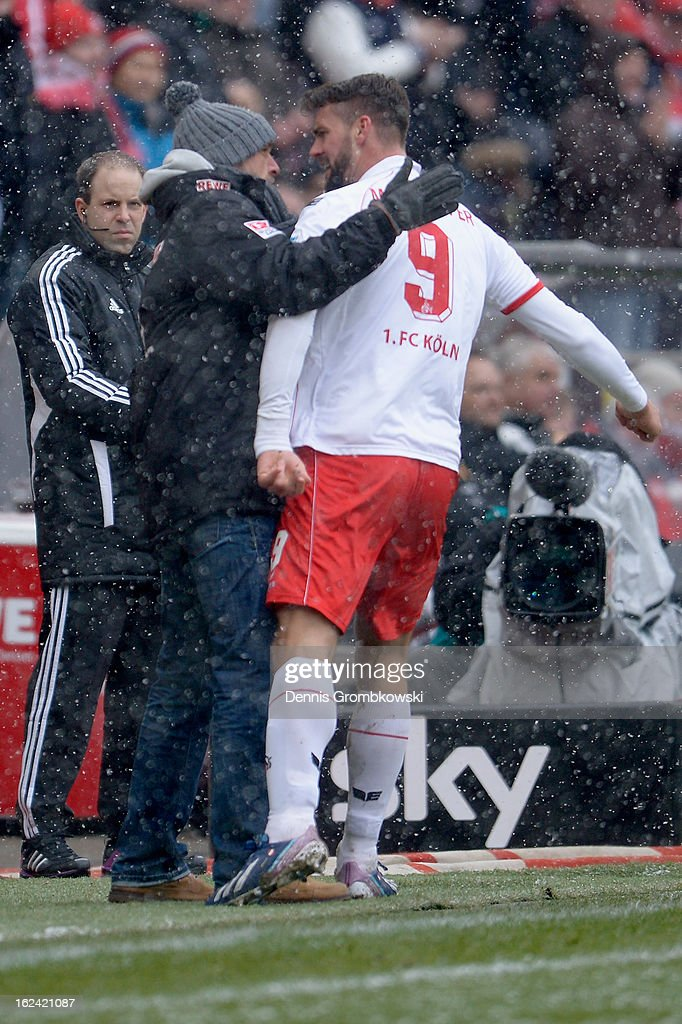 <a gi-track='captionPersonalityLinkClicked' href=/galleries/search?phrase=Stefan+Maierhofer&family=editorial&specificpeople=750774 ng-click='$event.stopPropagation()'>Stefan Maierhofer</a> of Cologne celebrates with head coach Holger Stanislawski after scoring his team's second goal during the Second Bundesliga match between 1. FC Koeln and Union Berlin at RheinEnergieStadion on February 23, 2013 in Cologne, Germany.
