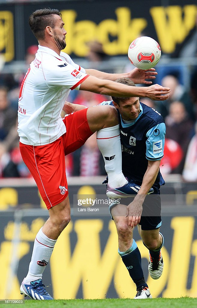<a gi-track='captionPersonalityLinkClicked' href=/galleries/search?phrase=Stefan+Maierhofer&family=editorial&specificpeople=750774 ng-click='$event.stopPropagation()'>Stefan Maierhofer</a> of Koeln challenges <a gi-track='captionPersonalityLinkClicked' href=/galleries/search?phrase=Moritz+Volz&family=editorial&specificpeople=217277 ng-click='$event.stopPropagation()'>Moritz Volz</a> of Muenchen during the Second Bundesliga match between 1. FC Koeln and TSV 1860 Muenchen at RheinEnergieStadion on April 28, 2013 in Cologne, Germany.