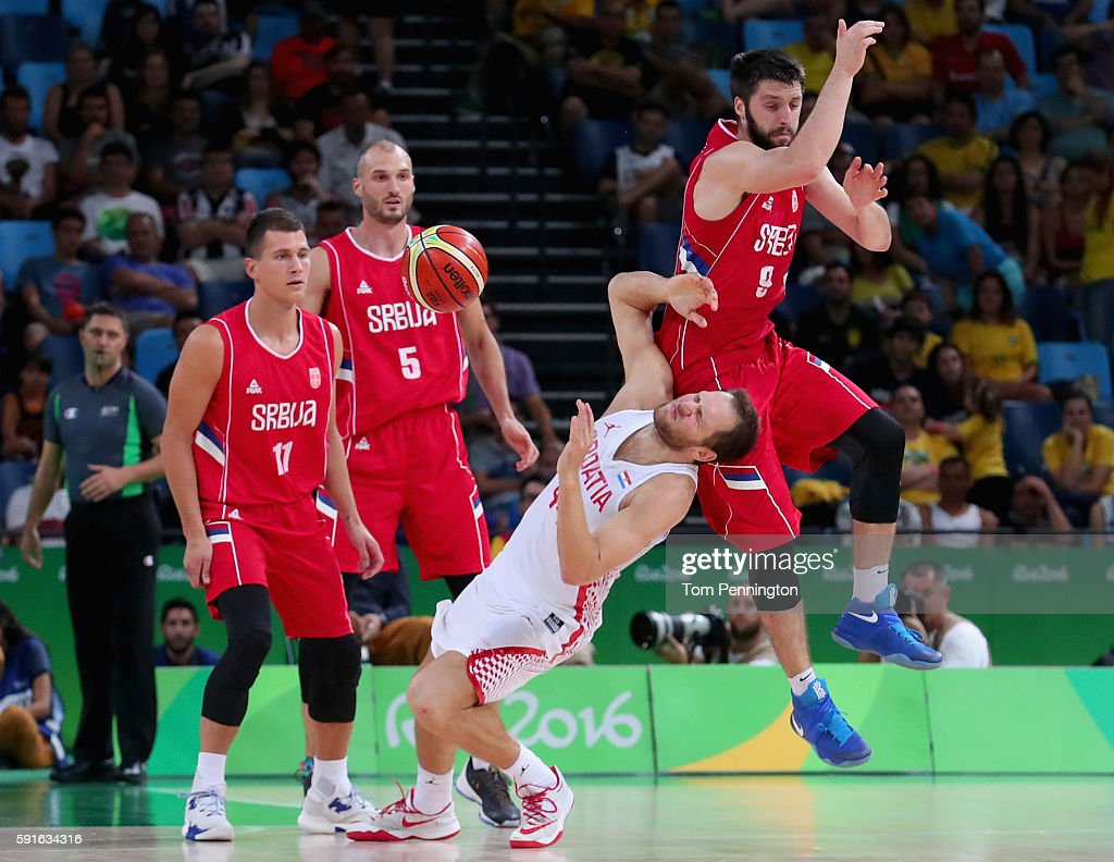 Stefan Markovic #9 of Serbia fouls Bojan Bogdanovic #44 of Croatia against Serbia Nemanja Nedovic #11 of Serbia and Marko Simonovic #5 of Serbia look on during the Men's Basketball Quarterfinal game at Carioca Arena 1 on Day 12 of the Rio 2016 Olympic Games on August 17, 2016 in Rio de Janeiro, Brazil.
