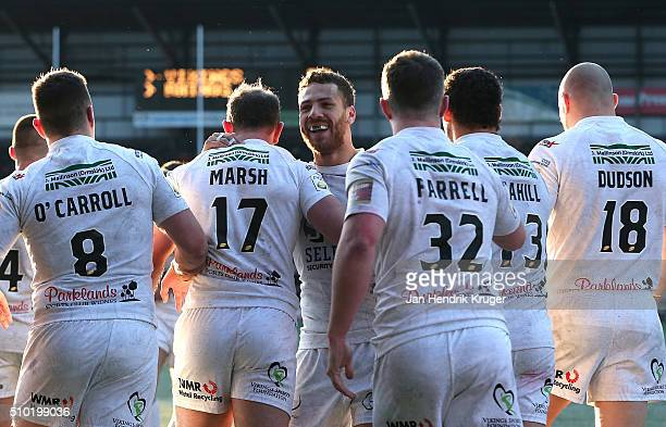 Stefan Marsh of Widnes Vikings celebrates his try with team mates during the First Utility Super League match between Widnes Vikings and Leeds Rhinos...