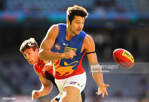 Stefan Martin of the Demons handballs during the round 19 AFL match between the Melbourne Demons and the Brisbane Lions at Etihad Stadium on August 3...