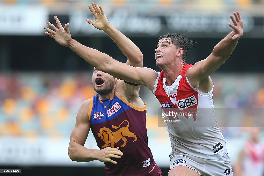 Stefan Martin of the Lions and Callum Sinclair of the Swans compete for the ball during the round six AFL match between the Brisbane Lions and the Sydney Swans at The Gabba on May 1, 2016 in Brisbane, Australia.