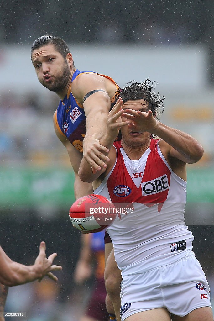 Stefan Martin of the Lions and <a gi-track='captionPersonalityLinkClicked' href=/galleries/search?phrase=Kurt+Tippett&family=editorial&specificpeople=779177 ng-click='$event.stopPropagation()'>Kurt Tippett</a> of the Swans compete for the ball during the round six AFL match between the Brisbane Lions and the Sydney Swans at The Gabba on May 1, 2016 in Brisbane, Australia.