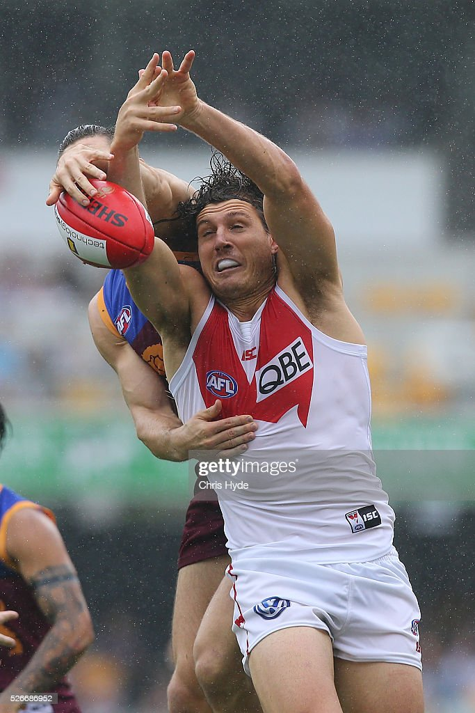 Stefan Martin of the Lions and Kurt Tippett of the Swans compete for the ball during the round six AFL match between the Brisbane Lions and the Sydney Swans at The Gabba on May 1, 2016 in Brisbane, Australia.