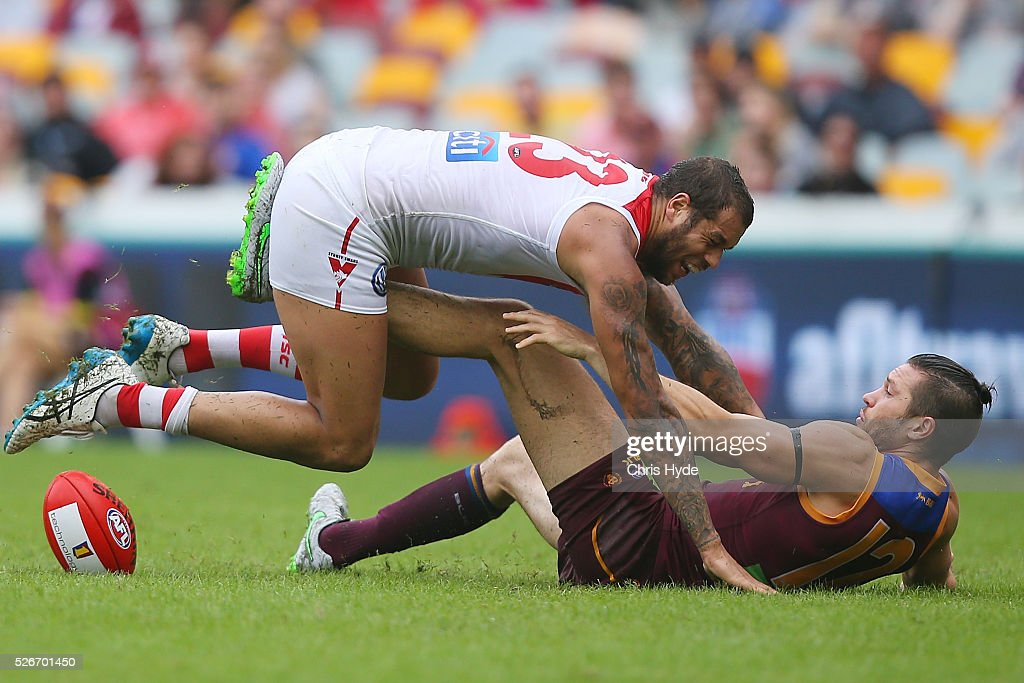 Stefan Martin of the Lions and Lance Franklin of the Swans compete for the ball during the round six AFL match between the Brisbane Lions and the Sydney Swans at The Gabba on May 1, 2016 in Brisbane, Australia.