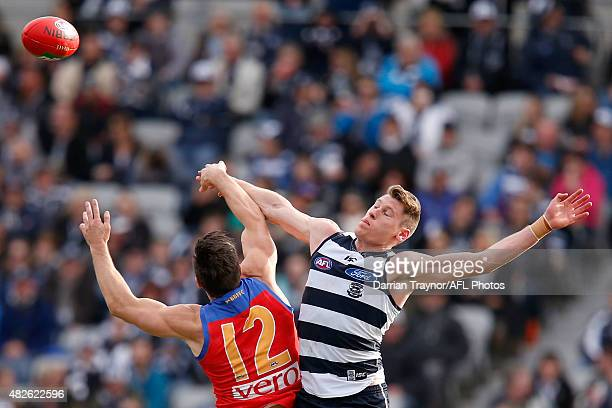 Stefan Martin of the Lions and Mark Blicavs of the Cats compete in the ruck during the round 18 AFL match between the Geelong Cats and the Brisbane...