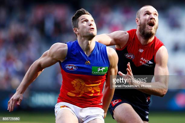 Stefan Martin of the Lions and Max Gawn of the Demons contest the ball during the round 22 AFL match between the Melbourne Demons and the Brisbane...
