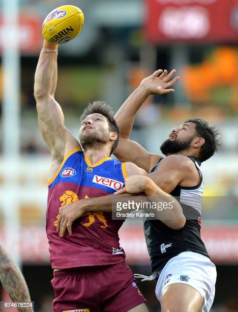 Stefan Martin of the Lions and Paddy Ryder of the Power compete for the ball during the round six AFL match between the Brisbane Lions and the Port...