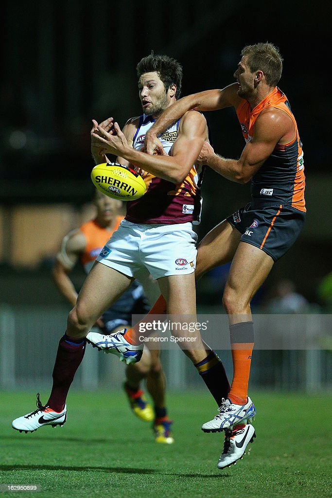 Stefan Martin of the Lyons and Stephen Gilham of the Giants contest the ball during the round two AFL NAB Cup match between the Greater Western Sydney Giantsand the Brisbane Lions at the Robertson Oval in Wagga Wagga, Australia.